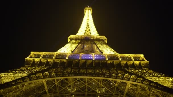 grand construction of eiffel tower illuminated with many bright