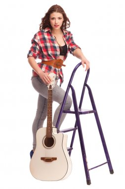 Young female musician with guitar