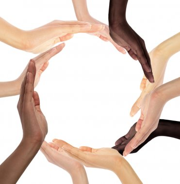 Multiracial human hands making a circle