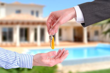 Commercial agent giving keys to customer horizontal composition