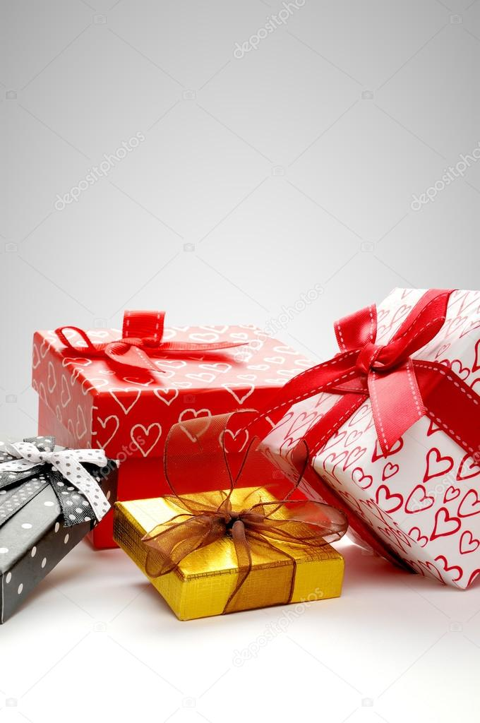 Group Gift Boxes With Bow Grey Background Vertical Composit Stock Photo