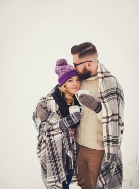 Embracing couple in park