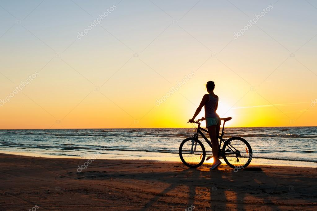 Moment in time. Sporty woman cyclist silhouette on multicolored