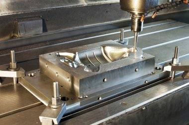 Industrial metal mold/blank milling. CNC technology and metal en