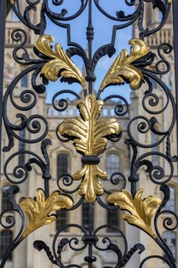 Golden leaves sign at the old gate of all souls college in Oxford