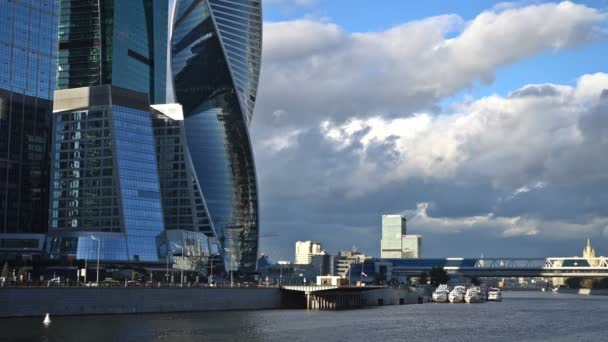 The clouds floating over the skyscrapers of the Moscow International  Business Center (Moscow-City), the Bagration Bridge and the World Trade  Center  Time-lapse  UHD - 4K  August 31, 2016  Moscow