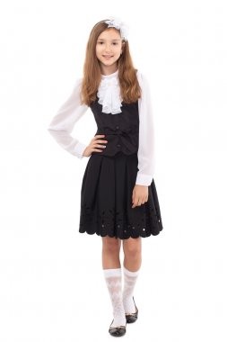 Pretty schoolgirl isolated on a white background