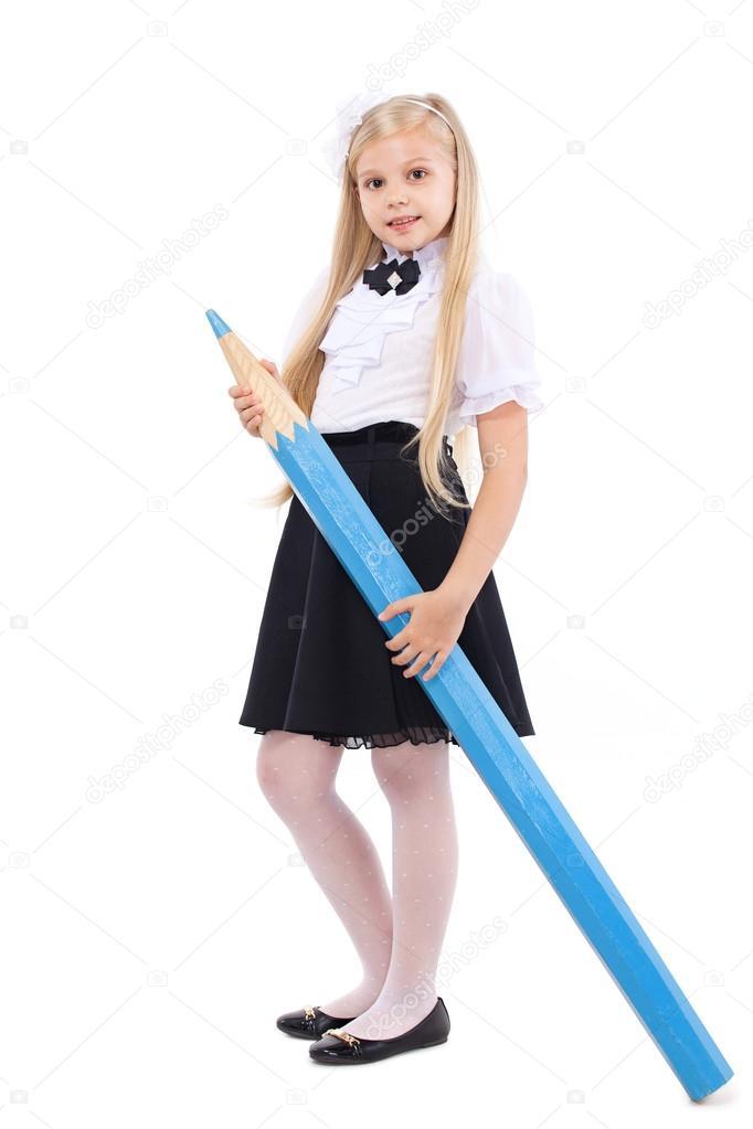 Pretty Blonde Schoolgirl With Big Blue Pencil Stock Photo