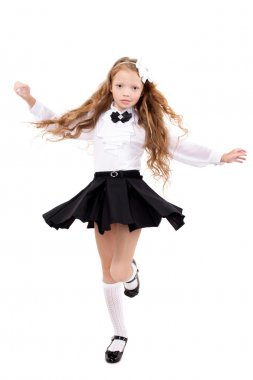 Pretty redhead schoolgirl isolated on a white background