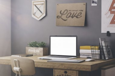 Stylish workspace with computer and posters on home or studio stock vector