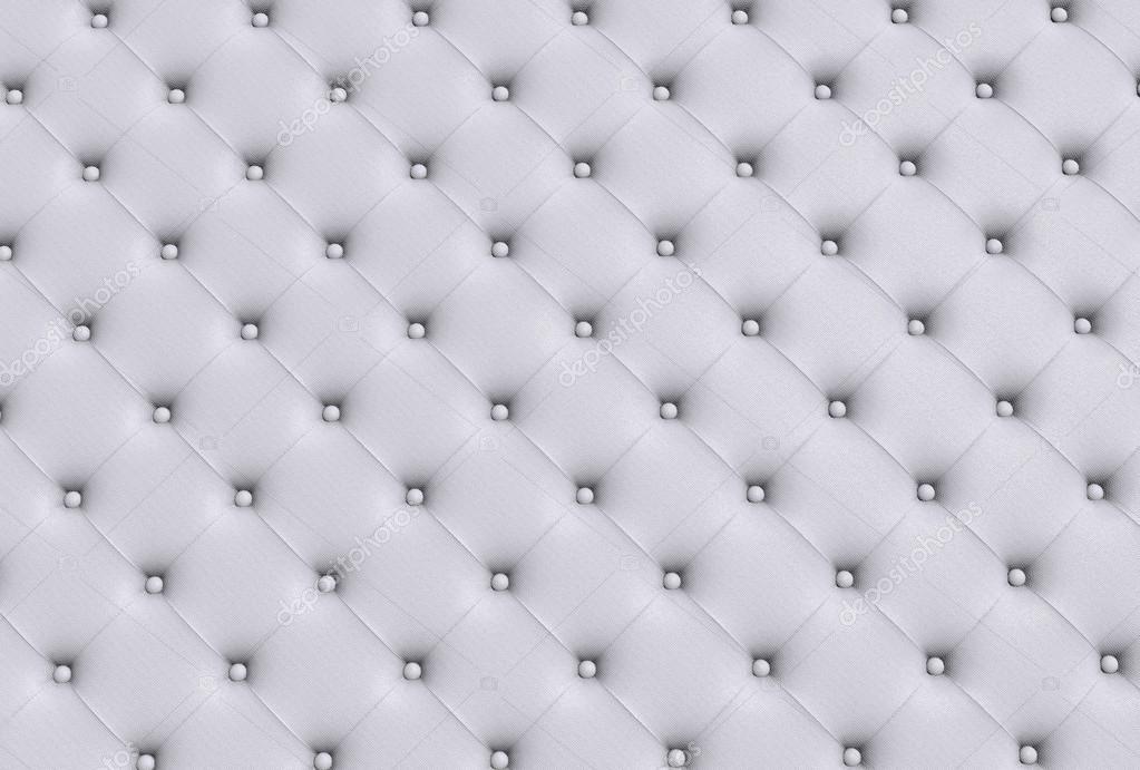 La texture della pelle bianca trapuntato divano foto for Divano trapuntato