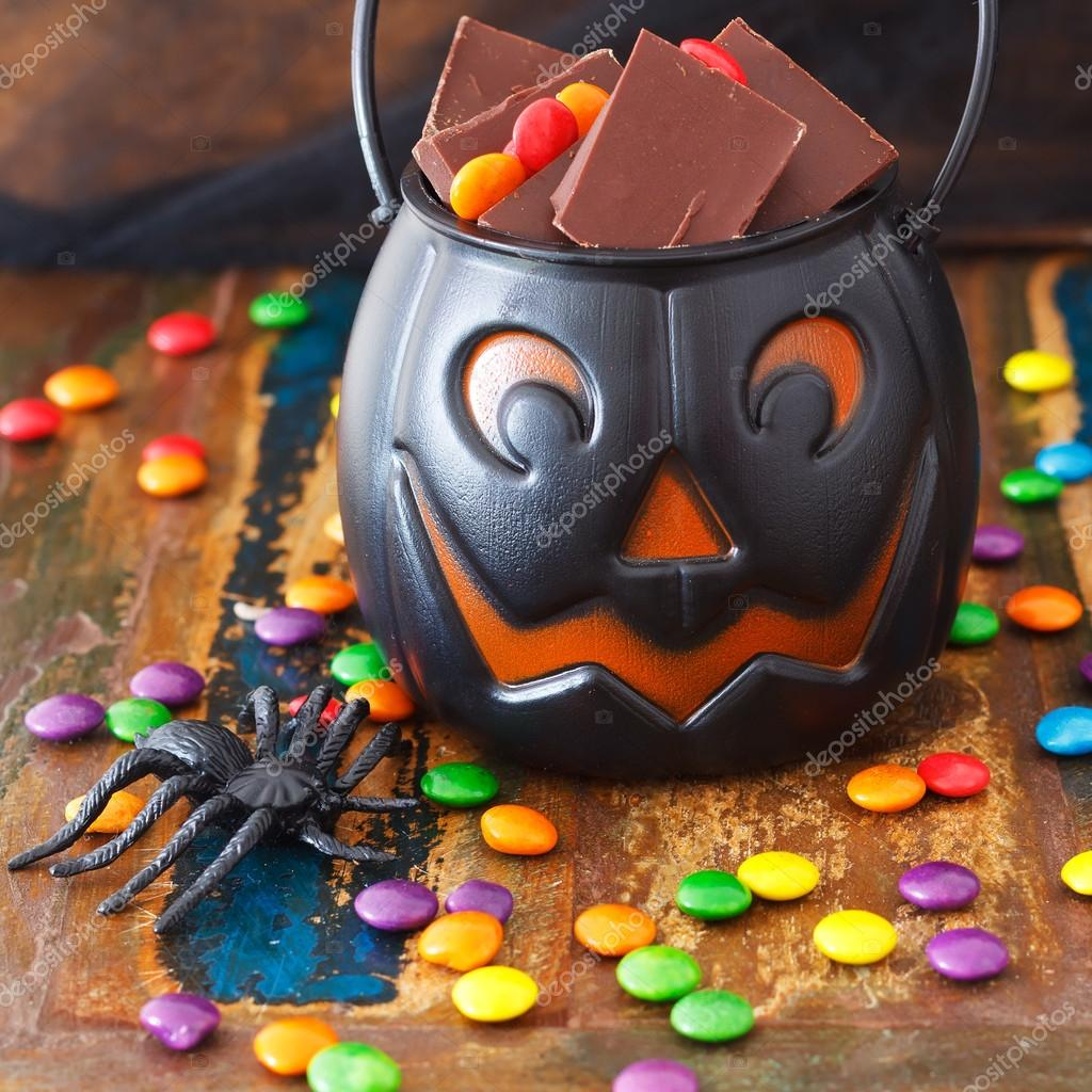 Halloween Sweets chocolate candy in pumpkin bowl, spide