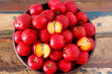 Red acerola (malpighia glabra), tropical fruit  in busket
