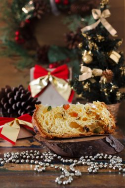 Piece of Panettone - sweet bread loaf with fruit traditional for