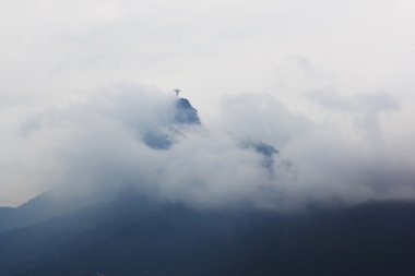 Mountain Corcovado with Christ the Redeemer in clouds and fog in