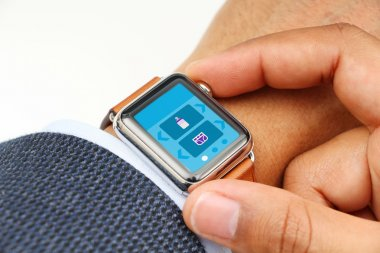 Businessman using baby tracker app on his smart watch