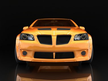 Sports car front view. The image of a sports gold car on a black background.