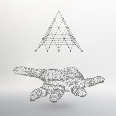 triangle pyramid on the arm. The hand holding a pyramid. Polygon triangle. Polygonal hand. The shadow of the objects in the background.