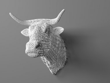Artificial bulls head hanging on the wall. Polygonal head of a bull. Cows from the three-dimensional grid. The object of art on the wall. Volume model. Meshwork.