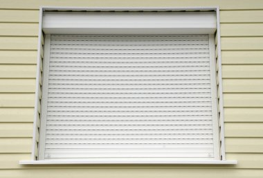 Window with white external blinds house