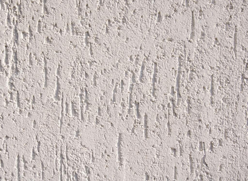 Intonaco grezzo bianco sul muro closeup foto stock for Intonaco rustico
