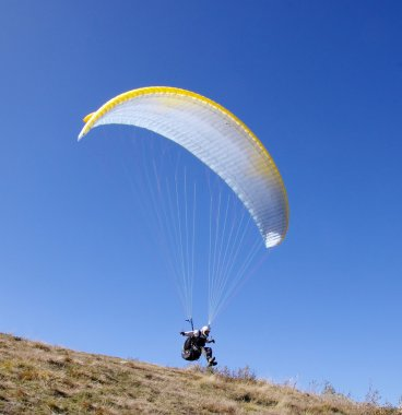 White paraglider on start