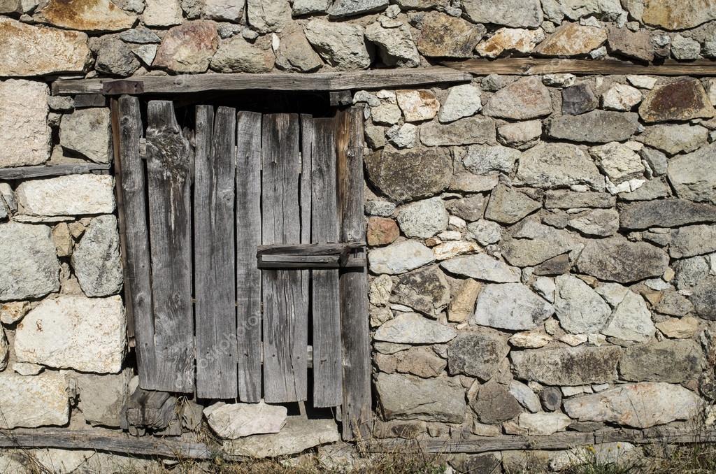Old stone wall with wooden padlocked door \u2014 Stock Photo & Old stone wall with wooden padlocked door \u2014 Stock Photo ...