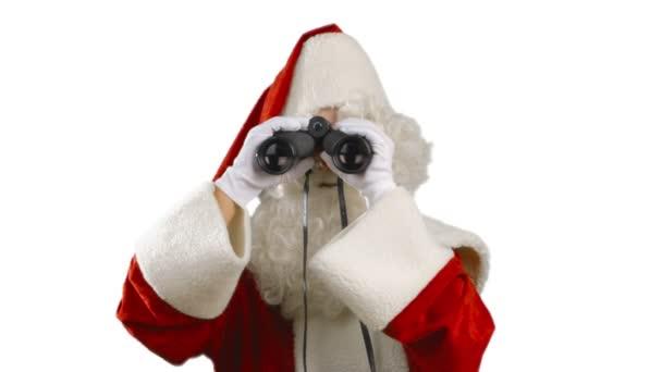 Santa Claus s dalekohledem rozhlížet