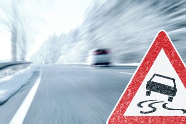 Winter Driving - Icy Road with Warning Sign