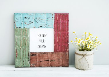 Colored red, gree, blue frame with chamomile FOLLOW YOUR DREAMS