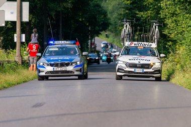 PORBKA NEAR BIELSKO-BIALA, POLAND - AUGUST 13, 2021: Cycling race Tour de Pologne 2021, stage 5 from Chocholow, Czarny Dunajec to Bielsko-Biala, professional cyclist riding throught streets in Porbka, near Kocierz
