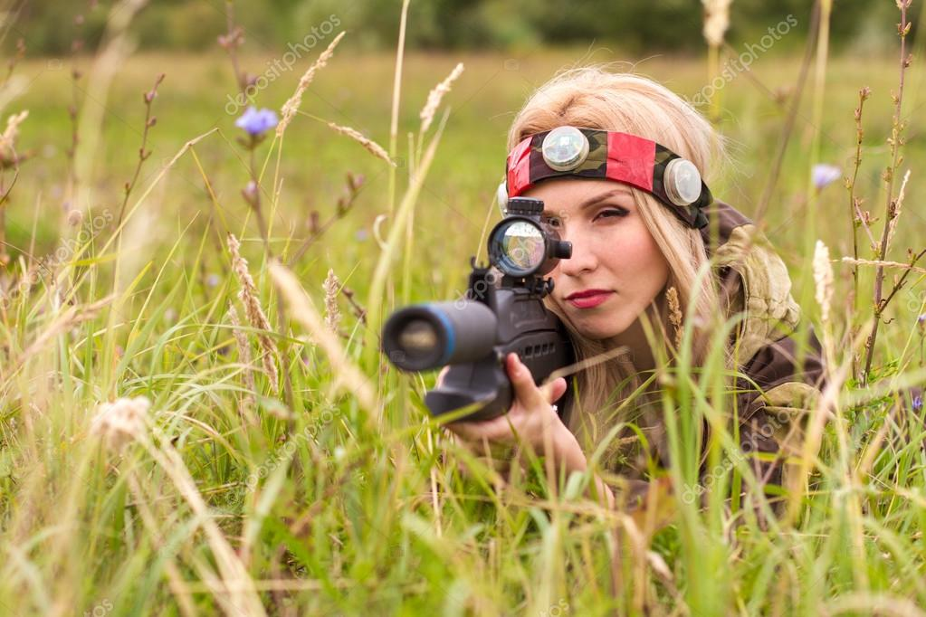 Woman looking into the optical sight
