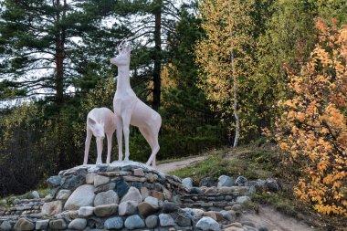 Sculpture of two deer on stones
