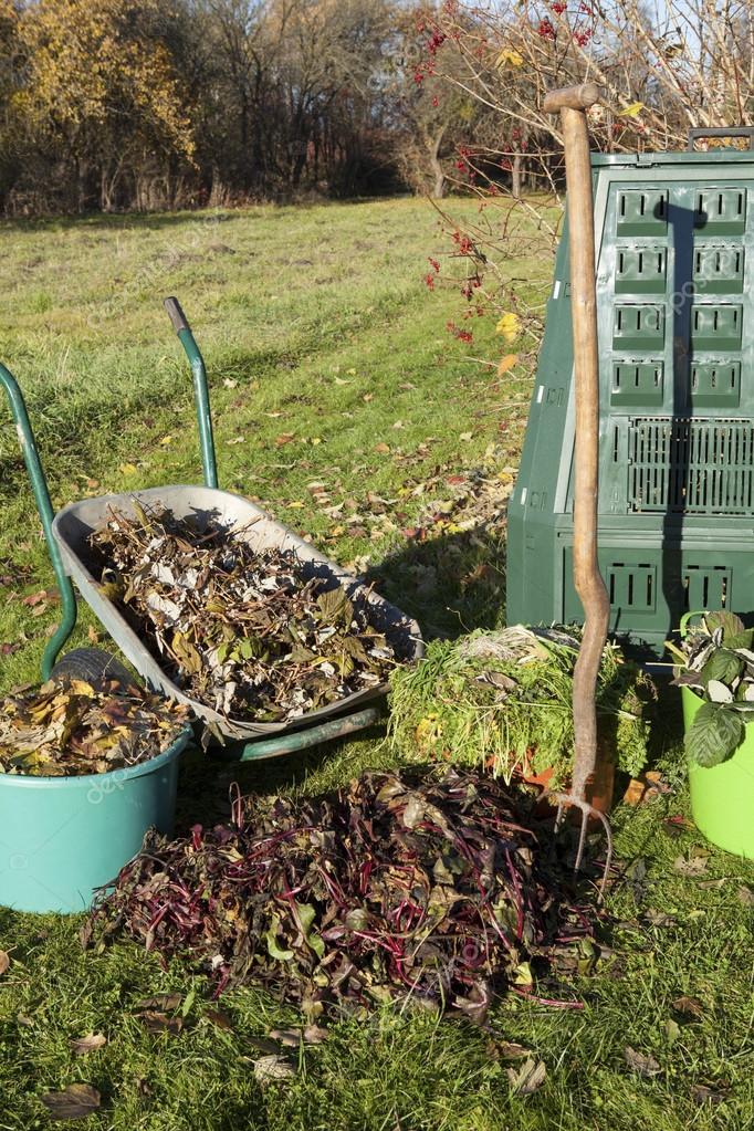 Composting in a autumn garden.
