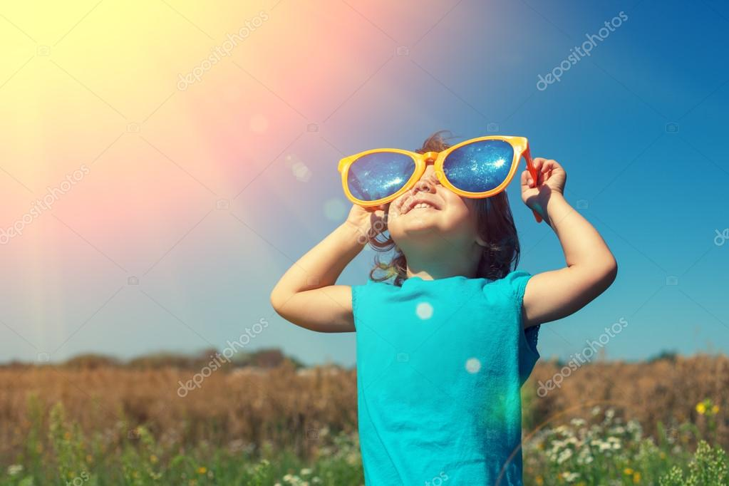 Little girl with big sunglasses