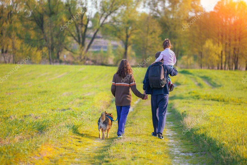 Happy Family Walking With Dog Stock Photo 81845046