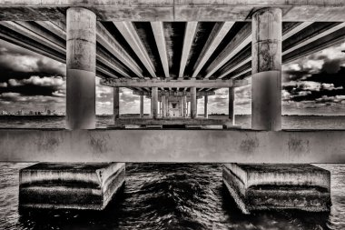 Underneath the Rickenbacker Causeway Bridge that connects Miami to Key Biscayne and Virginia Key. stock vector