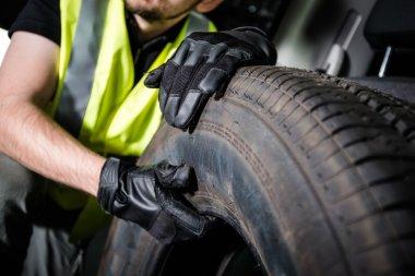 Worker Replacing Car Tire