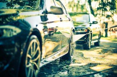 Two Cars Washing