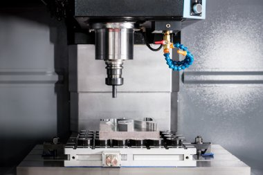 EDM or CNC industry machine working with coolant injection in in