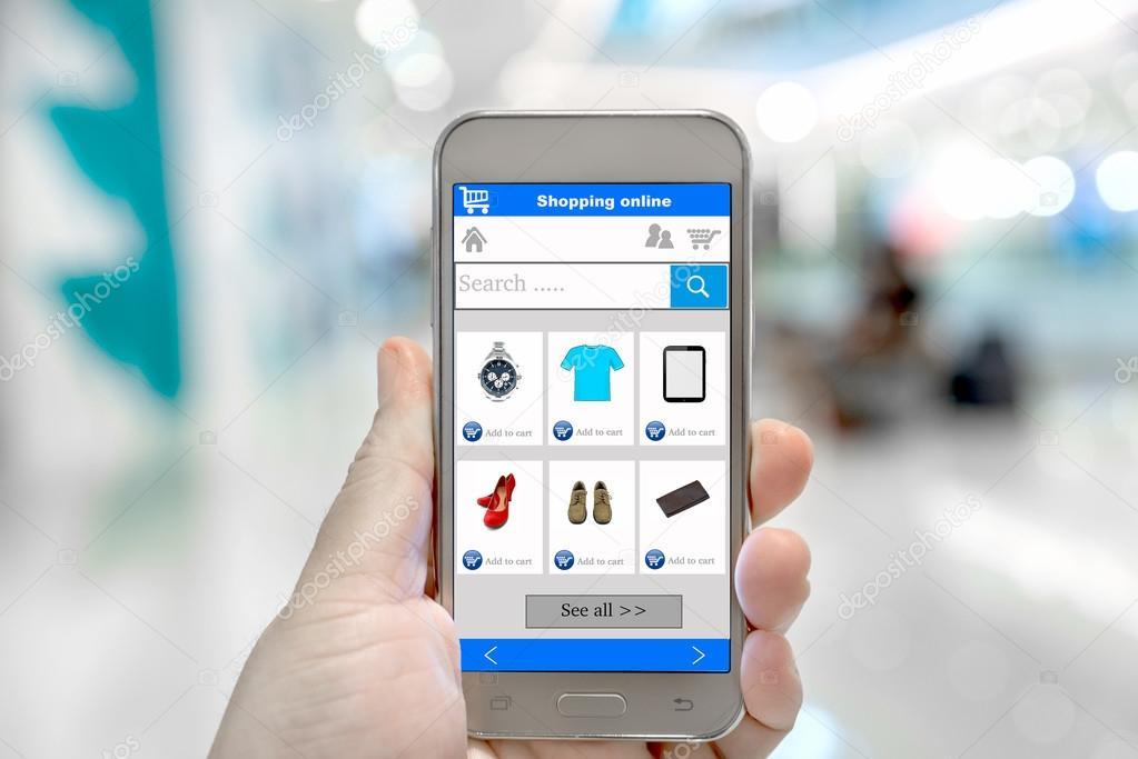 1c18ec732e43e8 Slimme telefoon online winkelen in de hand van de man. Winkelcentrum in de  achtergrond. Kopen van kleding schoenen accessoires met e commerce online  ...