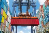 Shore crane lifts container during cargo operation in port