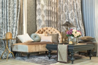 living room with classic looking sofa, luxuryl curtains, lamp an