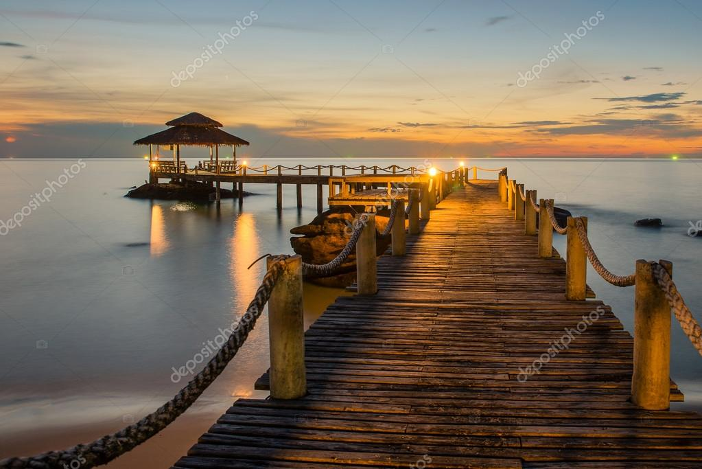Landscape of Wooded bridge pier between sunset