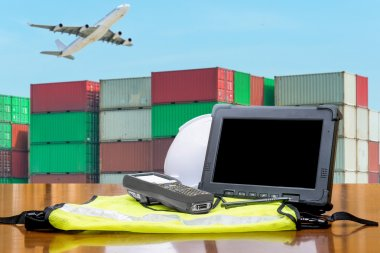 Rugged computers tablet checking containers for logistic concept
