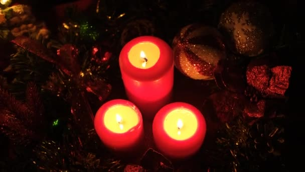 Christmas background with gift box and candle. Christmas and New Year decorations.