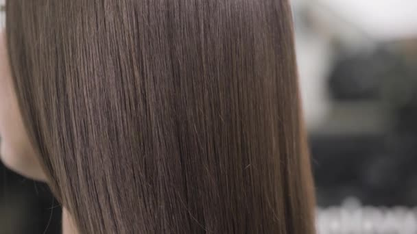 Demonstration of smooth and silky hair after straightening it with a steampod
