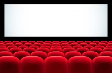 Cinema auditorium with rows of red seats and blank screen