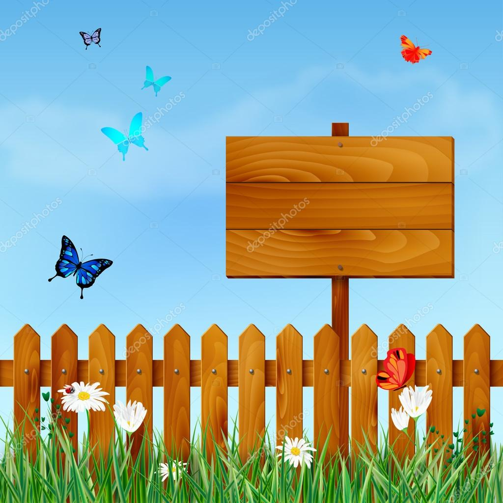 Wooden fence and sign on meadow with flowers and butterflies