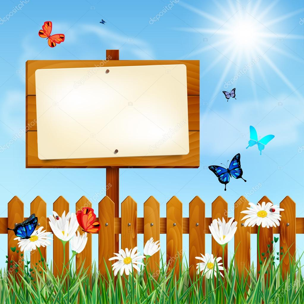 Wooden fence and blank sign on summer meadow